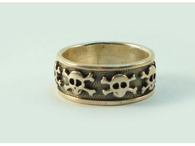 Кольцо серебряное с черепами